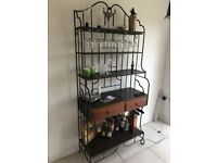 Dark oak and cast iron drinks cabinet.