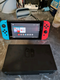 Nintendo switch v2 with 4 games and extras