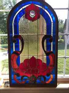 Stained glass panel in wood frame