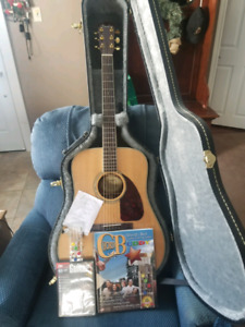 Acoustic & Electric Fender Guitar with Practice Books