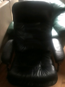 Black leather recliner with footstool