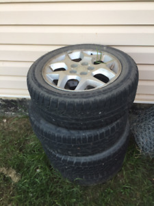 $100 - Four Aluminum Rims with Used Winter Tires, R15