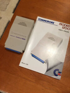 Commodore 1200 modem with manual - c64/128