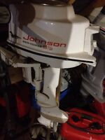 12 1/2 foot fiberglass boat with 5.5 Johnson outboard