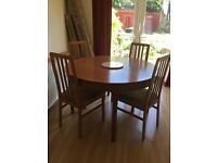 Extendable beech table and 4 chairs.