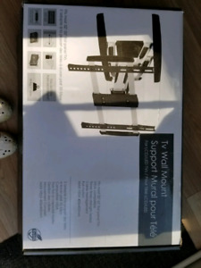 Tv wall mount ( New in the box )