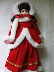 17 inch Porcelain doll with red velour outfit