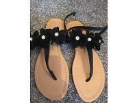 Size 5 black flowery and diamond flat sandals