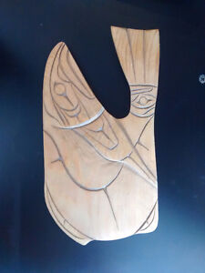 Salmon carved into wood