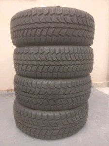 BARELY USED Uniroyal Tiger Paw 215 65R16 winter tires