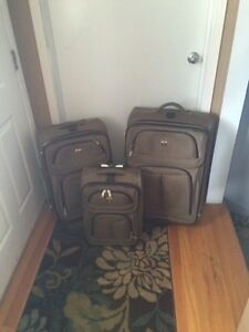 Set of three Swiss luggage bags