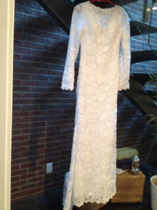 Beautiful lace wedding gown, in mint condition.