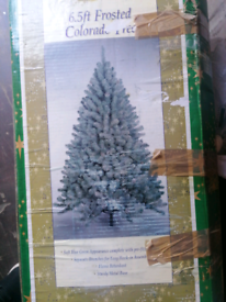 Modern 6ft 3in artificial Christmas tree with artificial snow