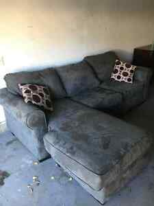 Grey couch with built on ottoman