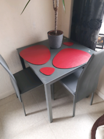 Grey glass table with 2 chairs