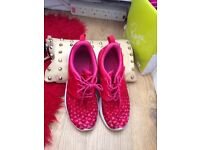 Pink Nike running shoes size 5
