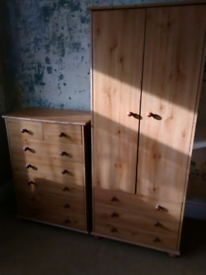 Wardrobe and chest of draws.
