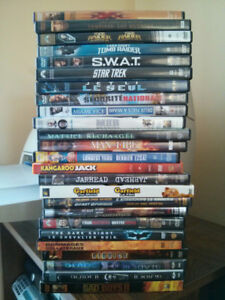 Over 30 DVDs of Movies and Shows