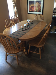 Solid Oak Dining table and chairs for sale.