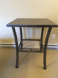 "Custom made steel table (33"" tall, 27"" square)"