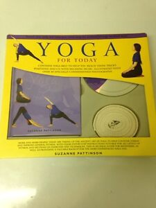 Yoga starter kit with belt, book, and DVD. 10$