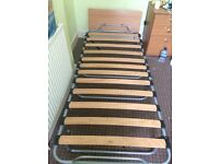 Foldable slated bed with mattress