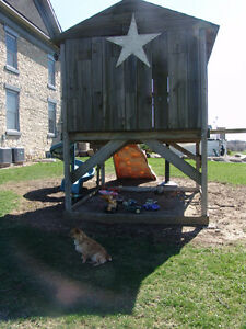 Children's rustic playhouse with Porch window sandbox shelter