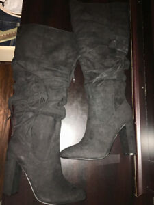 Black suede high heeled boots
