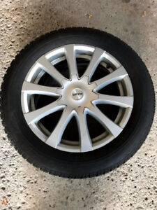 Winter set, 4 used (Alloy rims + Dunlop Tires), fits many makes.