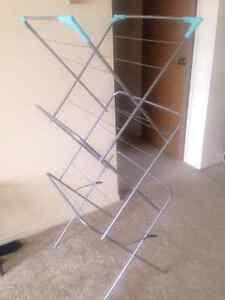 MOVING SALE.  Cloths rack