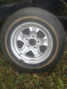 Brand new Firestone 14 inch tire with rim