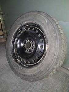 """4 Used winter tires 'Goodyear UltraGrip 215/60R16"""" with rims"""