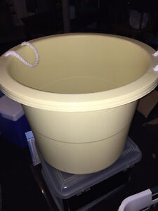 Plastic yellow tub with rope handles