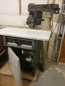 10in Craftsman radial saw with table and cabinet.
