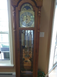 Solid Oak grandfather clock with chimes.