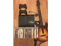 Slim PS3 500gb, 2/3 controllers, guitar hero guitar and 24 games