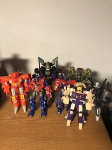 Various Transformers Voyager Class figures.