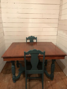 Antique table and 6 chairs.