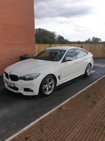 Alphine White BMW 318D GT Sport
