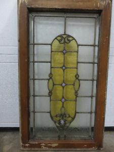STAIN GLASS WINDOW IN GREAT CONDITION outside the wood frame is