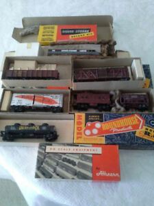 Antique HO scale model train cars and locomotive.