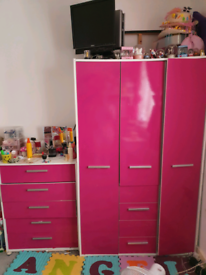 girls pink wardrobe, chest of drawers and bedside table