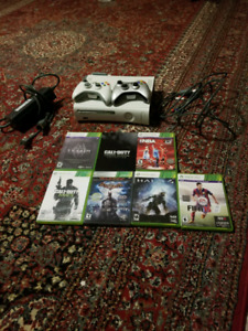 Xbox360 with 2 controller and 7 games