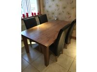 Oak dining room table and four chairs