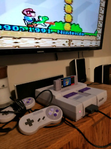 Super Nintendo Entertainment System with extras