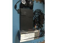 Ps2 slimline console with official controller, memory card and 5 games PlayStation