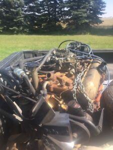 Wanted. Th200r4 transmission and carburetor