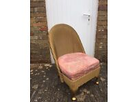 Occasional wicker chair with sprung seat