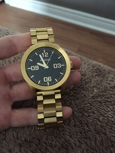 Selling Nixon gold watch mint condition  London Ontario image 1