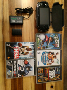 PSP (1001) + case + 5 games + memory stick + extra battery